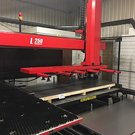 Amada automated sheet loader and part remover were added to the EMZ 3510 Electric turret punch.